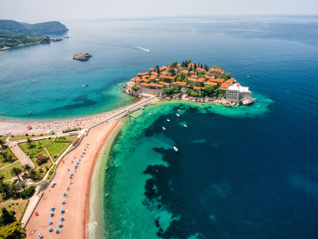 """Aerial photo of Sveti Stefan (St. Stefan) island, an luxury resort famous for its traditional architecture, located on the coast of Adriatic Sea, near Budva city, Montenegro, Europe. Photo was taken from the helicopter.Related:"""